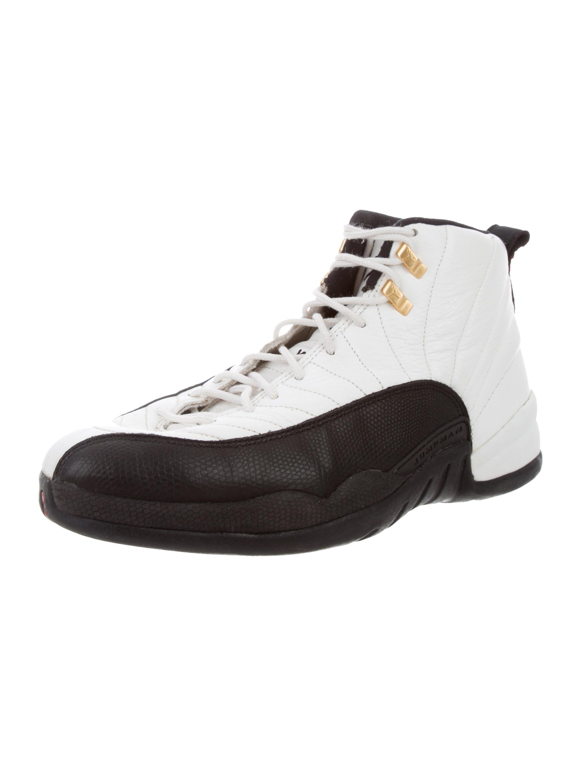 premium selection 6b19c ec0f9 From the 1996 Collection. Men s black and white Nike Air Jordan 12 OG Taxi  high-top sneakers with round toes, rubber soles and lace-tie closures at up