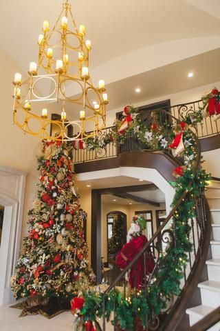 grand staircase christmas decor 12 foot christmas tree entry way christmas decor red gold and silver christmas gold chandelier garland hung on - Red Gold And Silver Christmas Decorations
