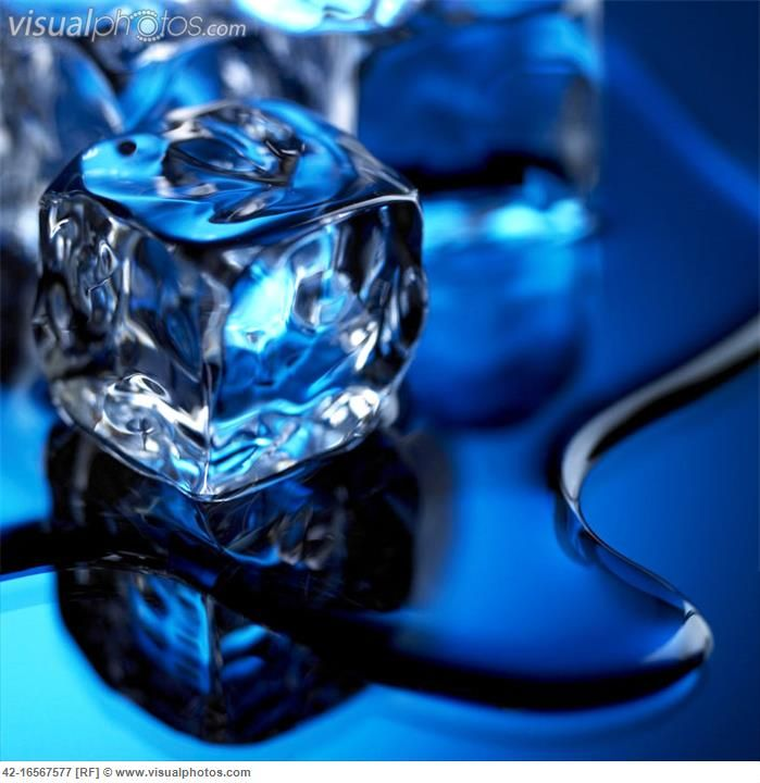 Ice cubes melt into a puddle of clear water in a blue ...