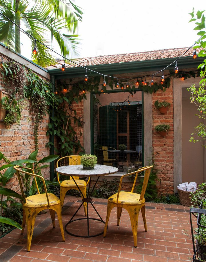 Lovely little patio. Like the tiny table. Really cozy and with the yellow chairs bright.