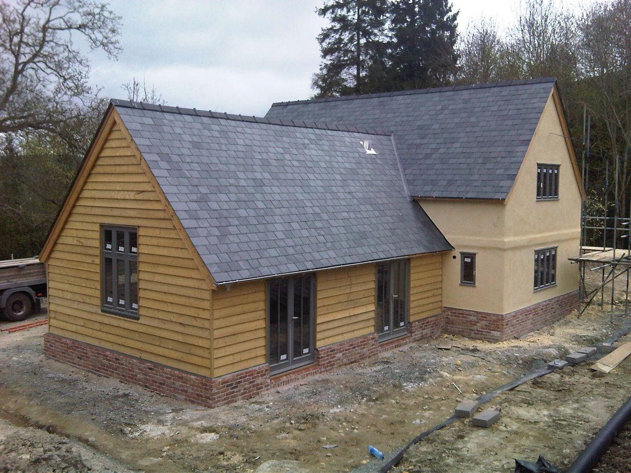 Border oak weatherboard and render border oak barns for Weatherboard garage designs