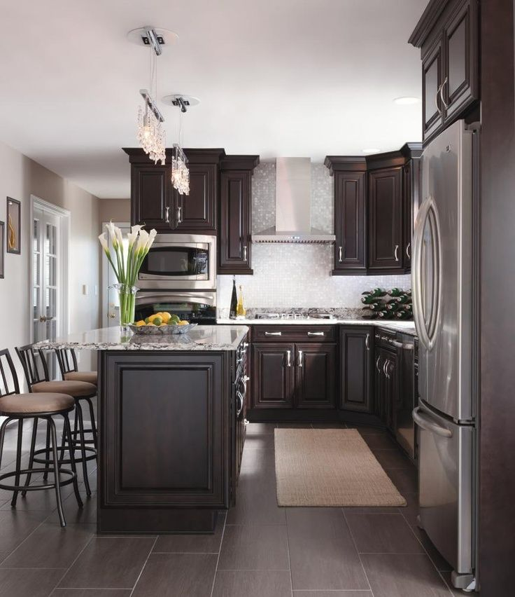 Dark brown cabinetry with a sparkly backsplash #cabinetsolutionsusa ...
