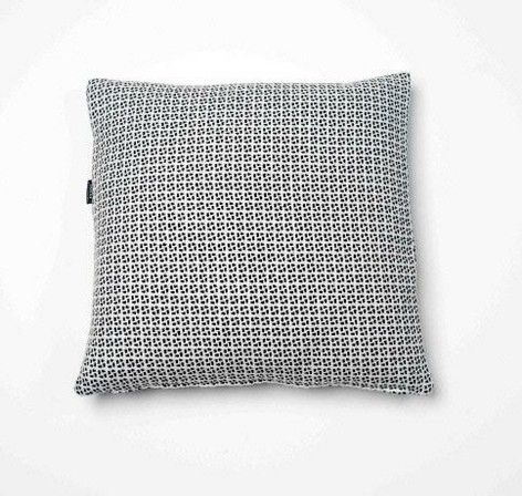 Compasso cushion in woven black/white wool pattern. From mydeco.com