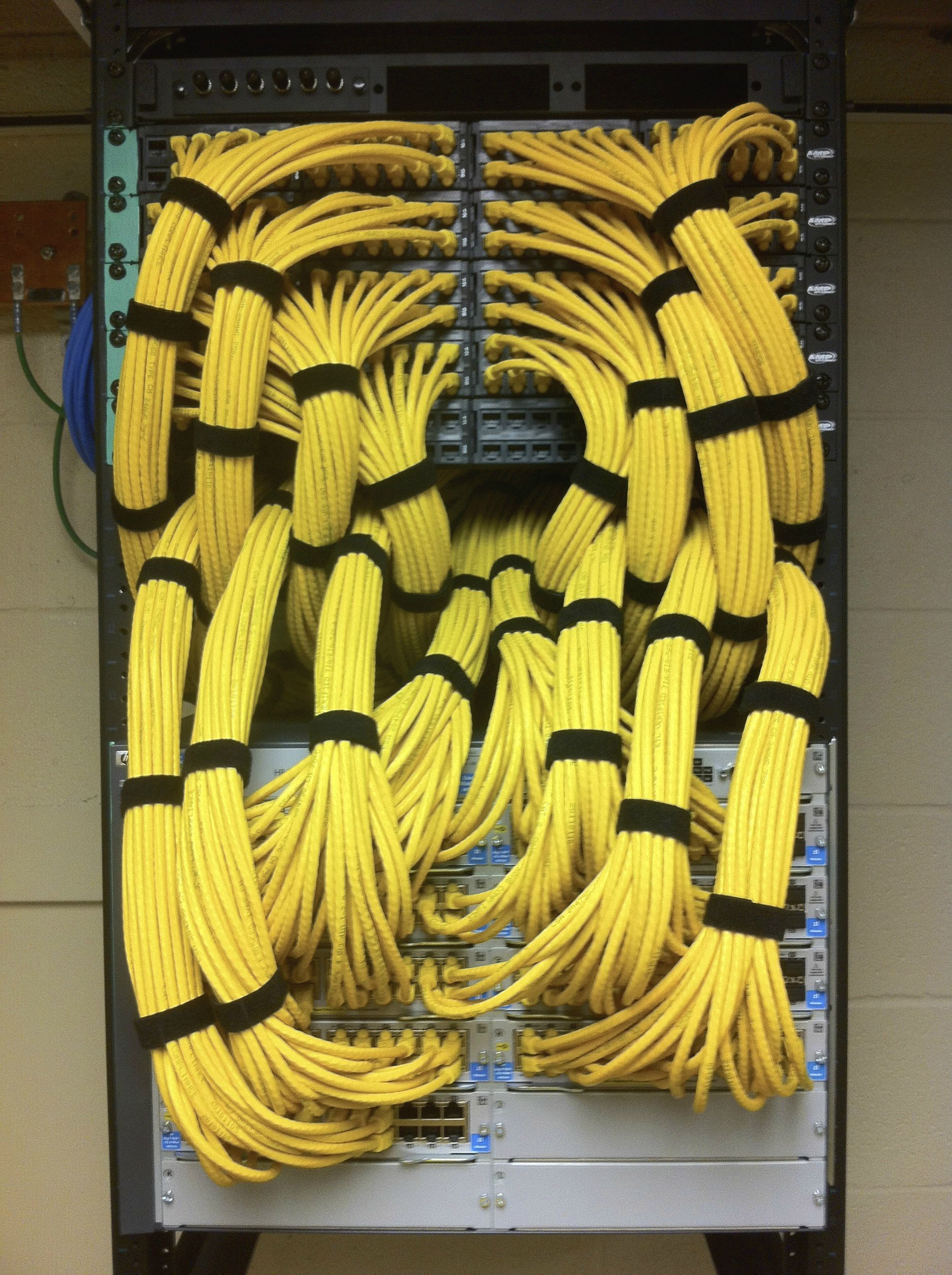 great patch panel install into a modular switch  yellow ethernet cabling  install at an elementary school