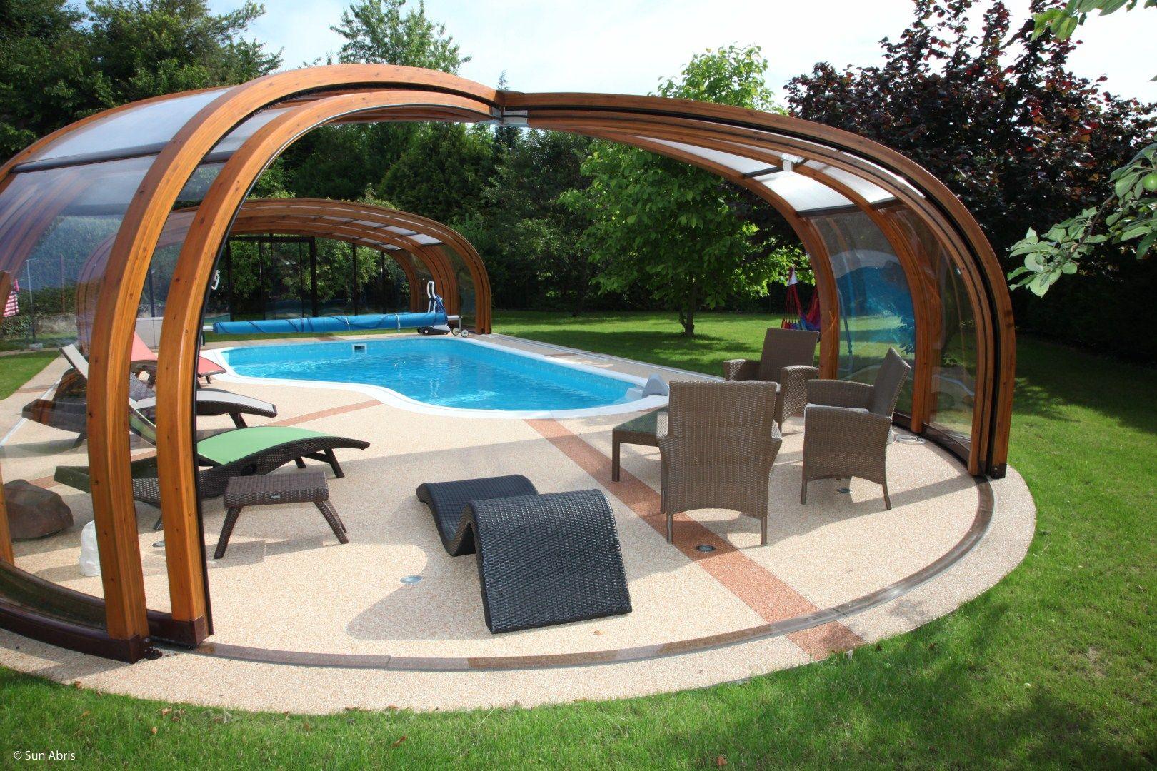 Abri de piscine en bois en lamell coll pour qu for Abris piscine bois