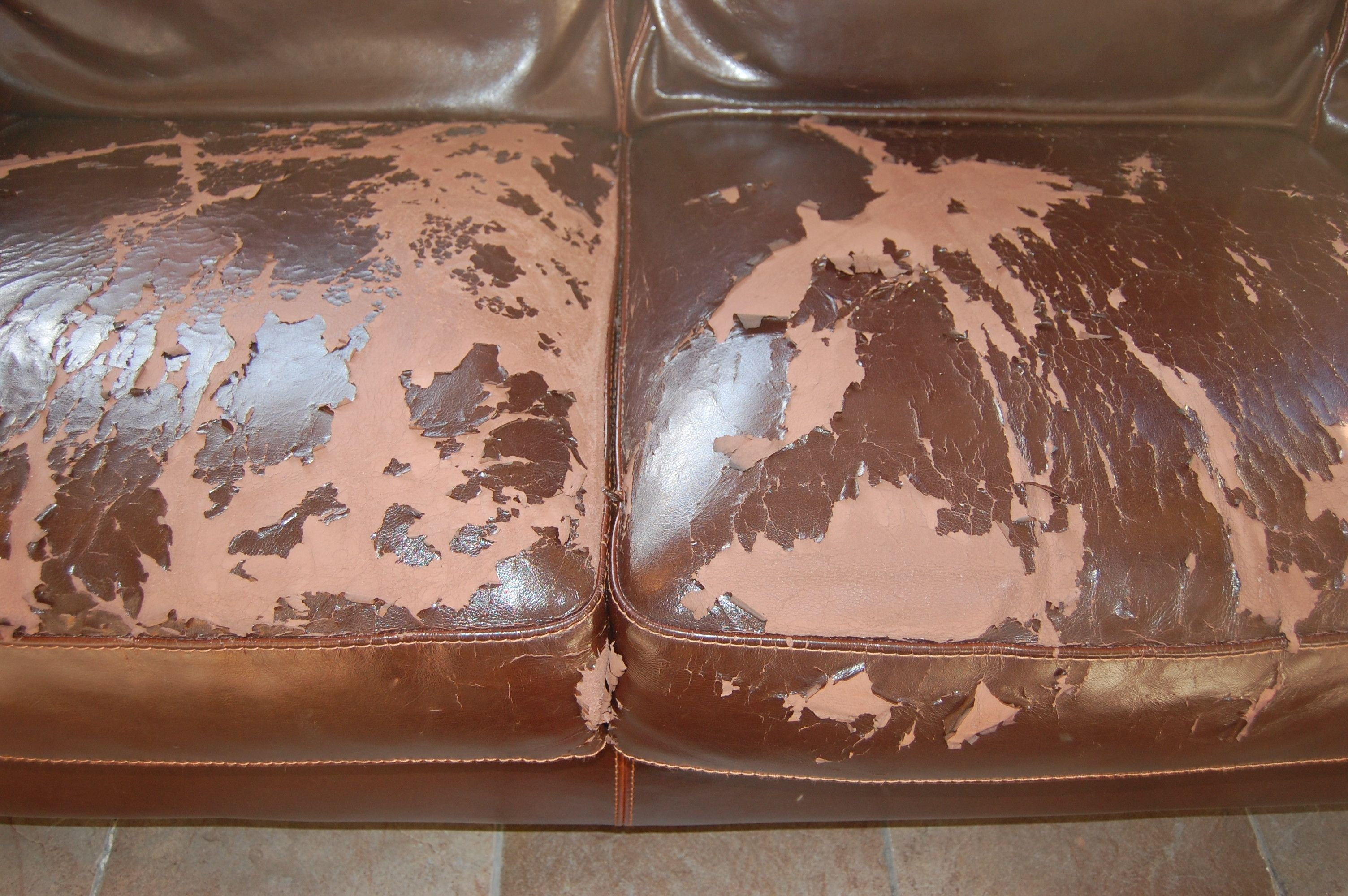 how to repair a large tear in leather sofa dark taupe reclaimed look tempered glass table fix