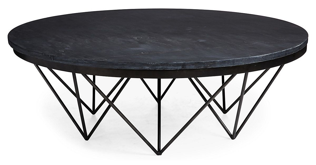 This Round Coffee Table Is Anchored By A Captivating Geometric