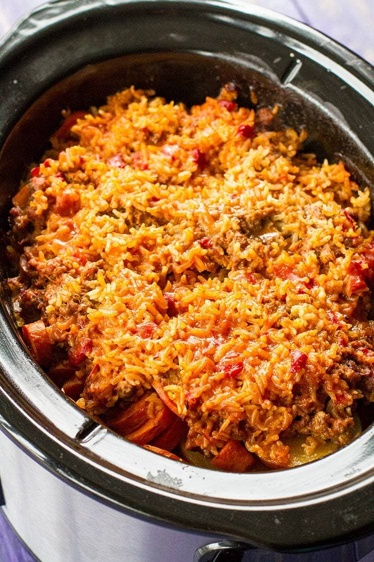Ground Beef Shipwreck Casserole It S Layers Of Onions Potatoes Ground Beef And Rice In 2020 Slow Cooker Dinner Crockpot Recipes Slow Cooker Crockpot Recipes Easy