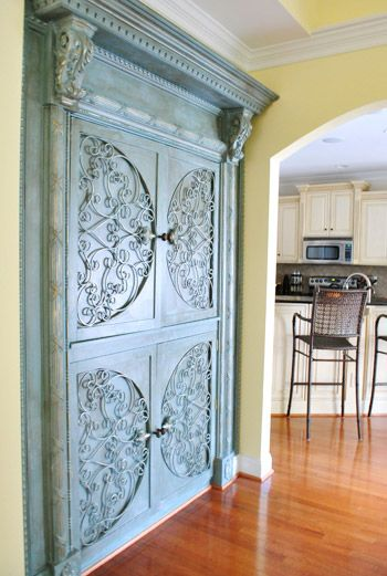 Custom cabinet designed using reclaimed wood and ironwork.