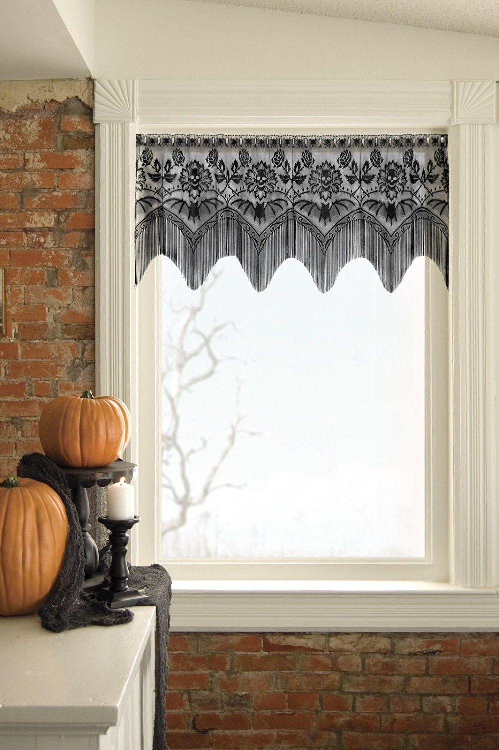 Spiders and skulls, complete with #gothic fringe, set a scary scene - halloween window decor