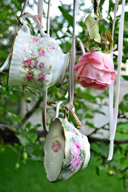 Teacups hanging from  trees is a great Shabby Idea!
