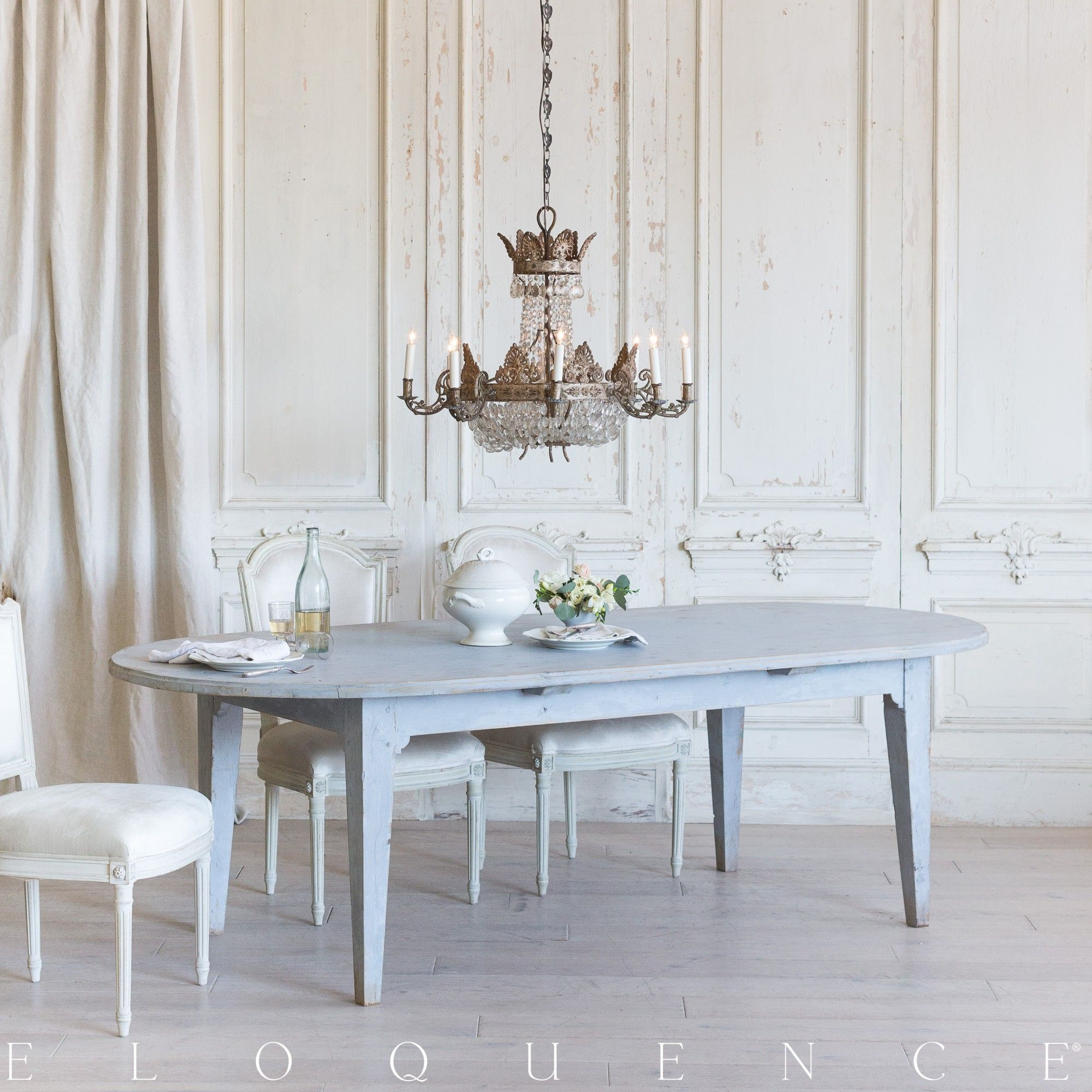 A eloquence oval dining table in a highly