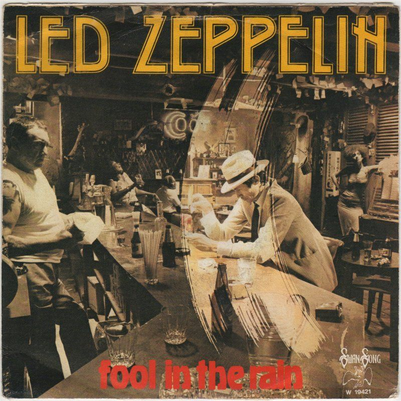 Led Zeppelin, Fool In The Rain ..great tune! ) Led