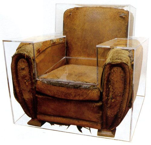 Old Leather Chair Encased In Clear Acrylic Chair By Maurice Renoma  Currently On Loan To The Louvre.