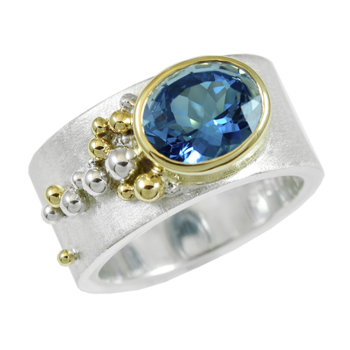 size: 7.75  width: 10.5mm  metal: sterling silver with 14k yellow gold bezel and balls center stone: 3.02ct AAA natural blue topaz