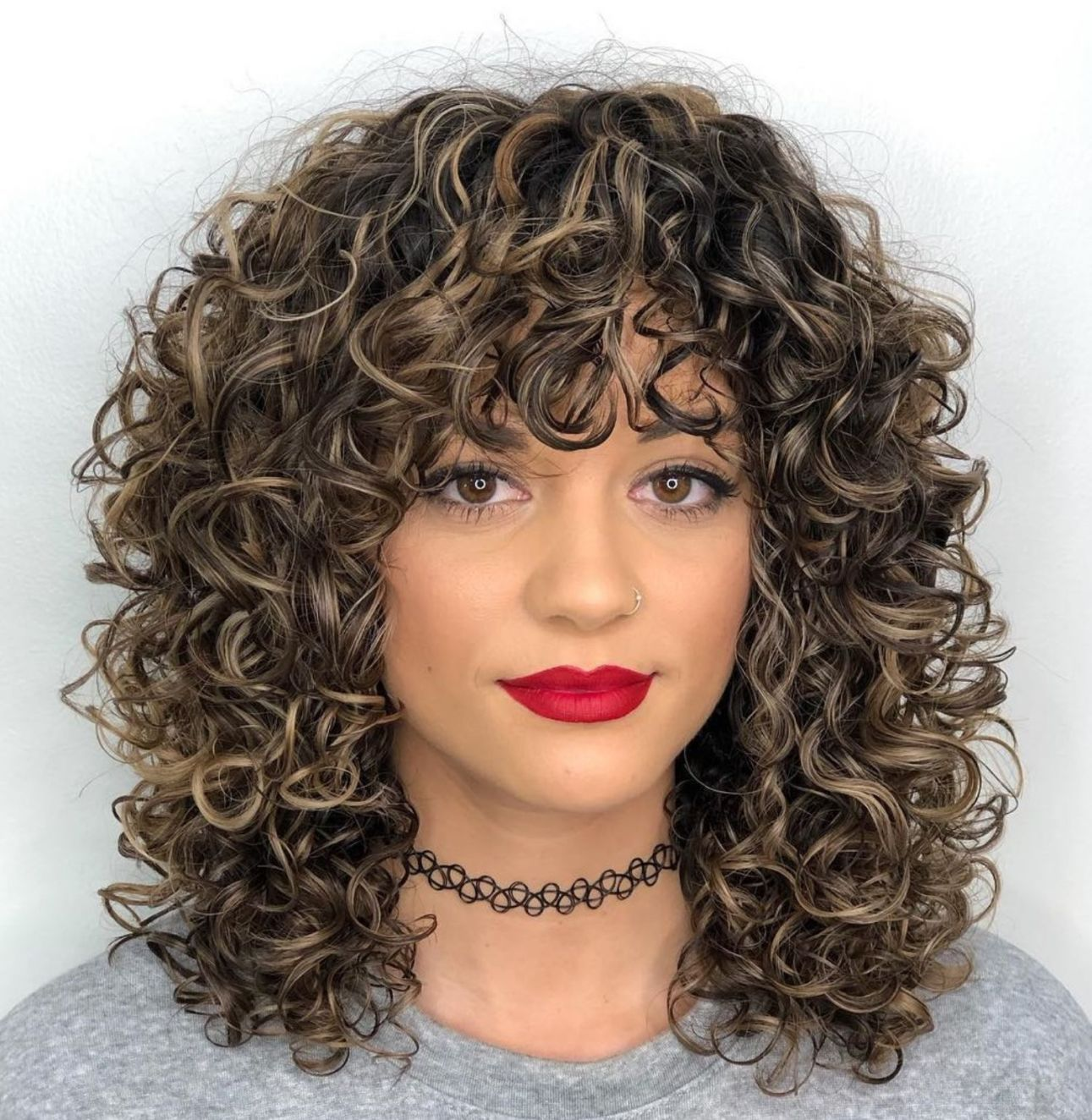 Mid Length Curly Hairstyle With Curly Bangs In 2020 Medium Curly Hair Styles Curly Hair Styles Naturally Curly Hair Styles