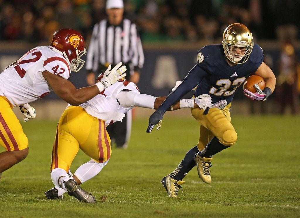 Cam McDaniel 33 of the Notre Dame Fighting Irish breaks a