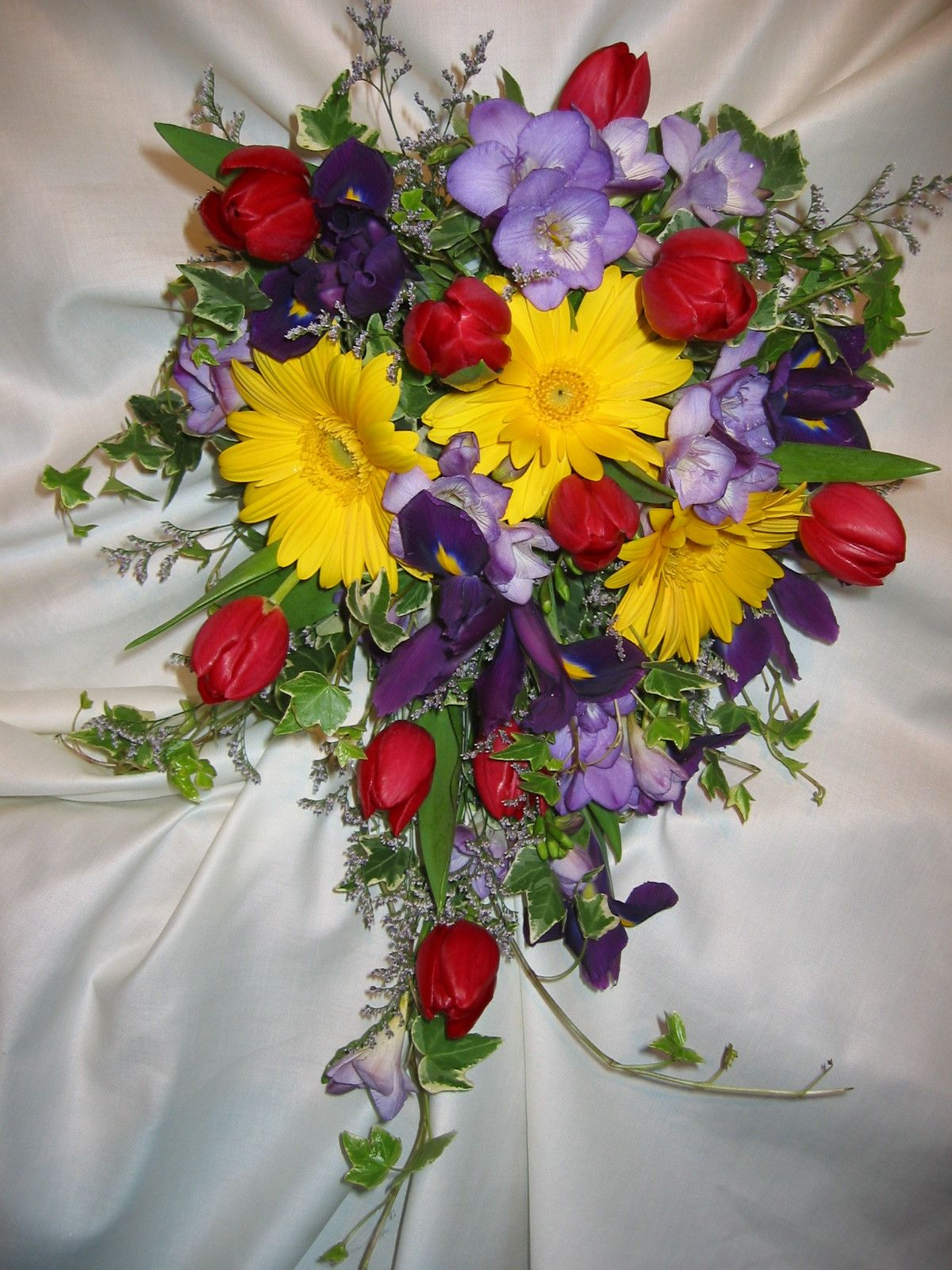 Wow A Striking Color Combination Yellow Gerbera Daisies Purple Freesia Red Tulips Purple