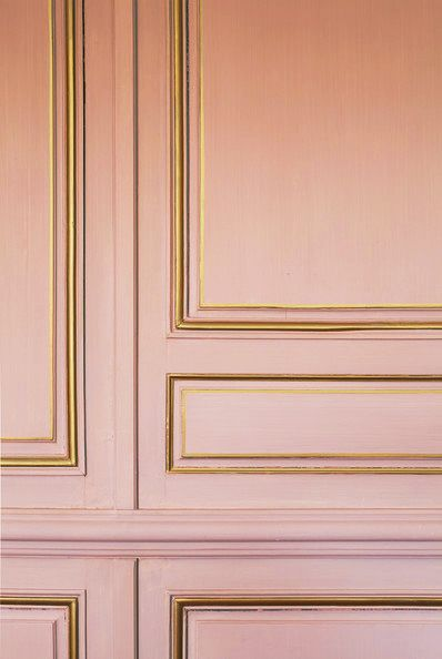 Blush + Gold wall, french interior design style, feminine bedroom, elle decor furniture peach gilt trim walls moulding