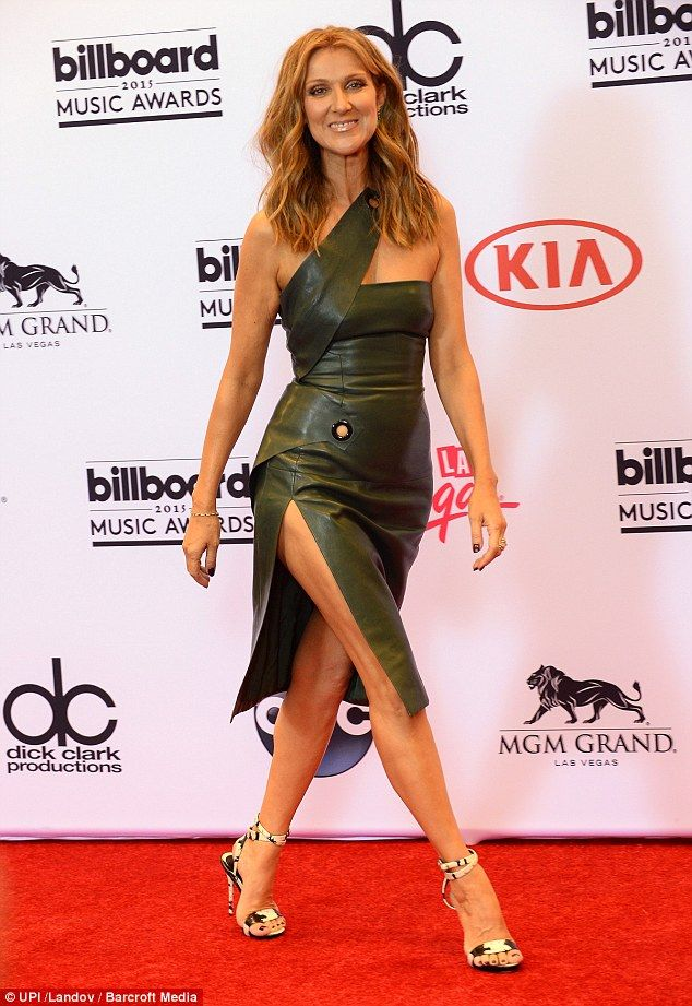 Goddess in green: Celine oozed confidence in the flattering green number
