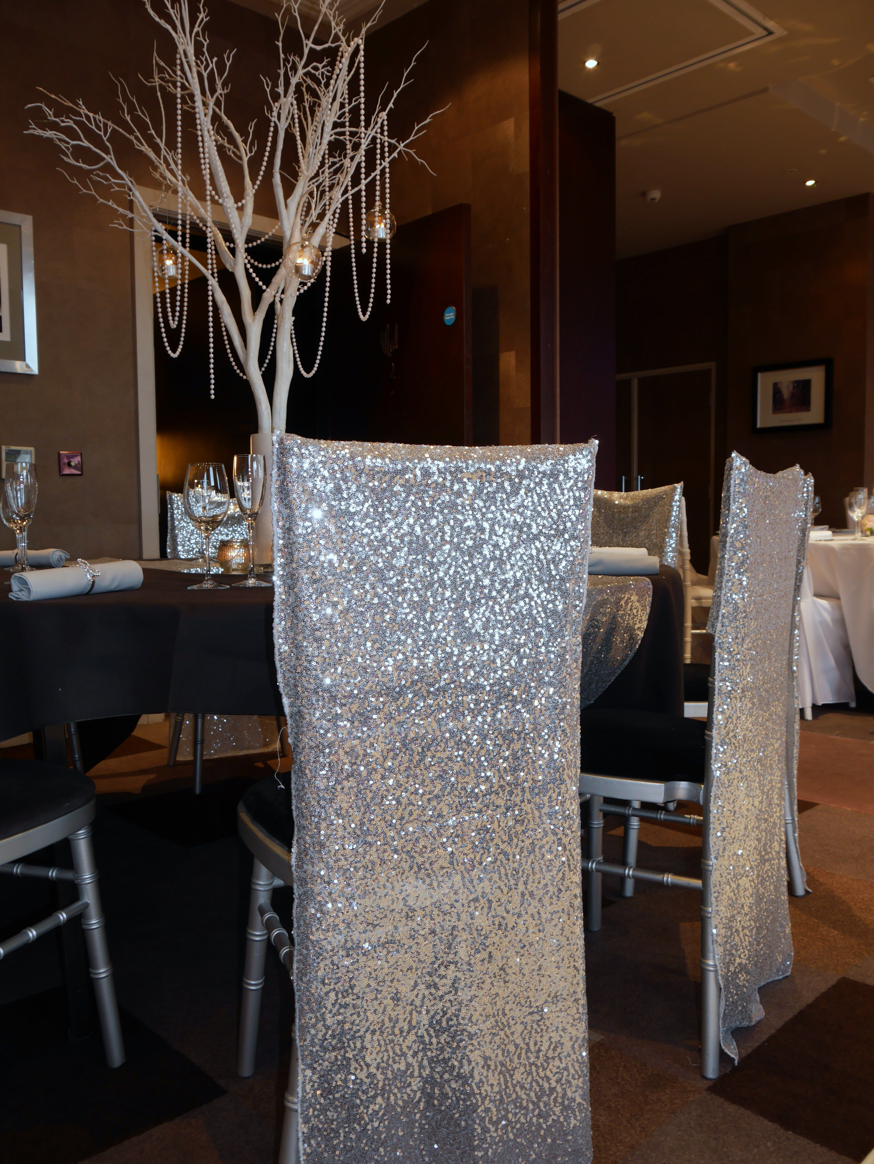 Silver sequin chair covers look great over Chiavari chairs