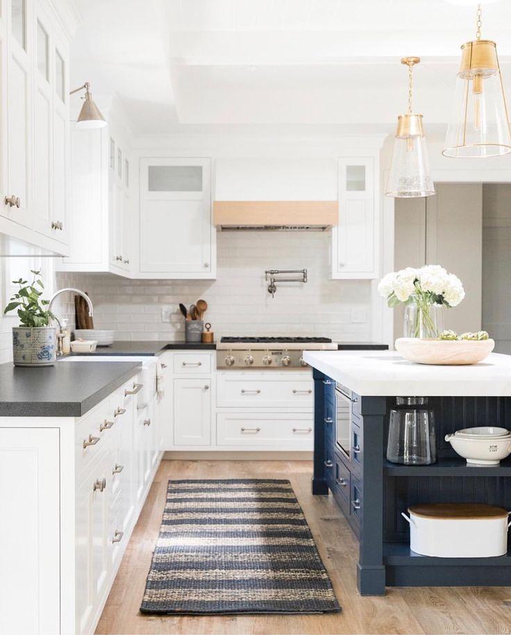 White Kitchen Cabinets With Dark Blue Island