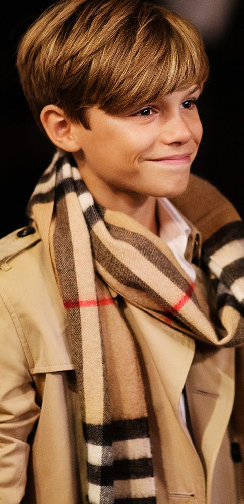 In A Heritage Trench Coat And Scarf Romeo Beckham Leads An