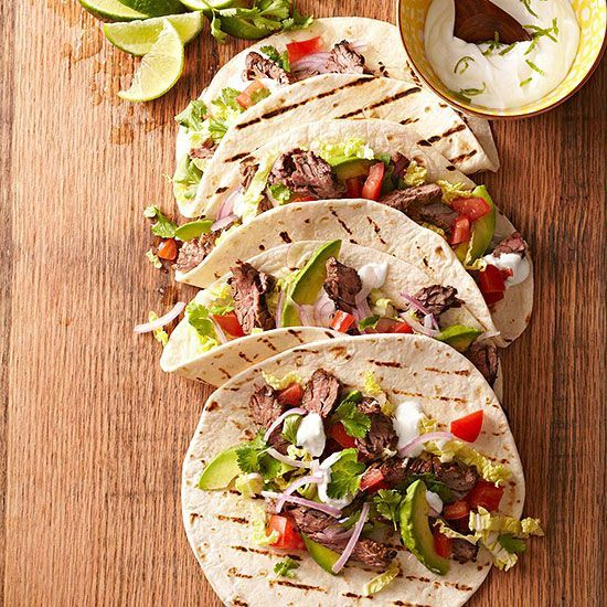 Skirt Steak Tacos with Lime Crema. More ideas for summer grilling: http://www.bhg.com/recipes/grilling/best-grilling-recipes/