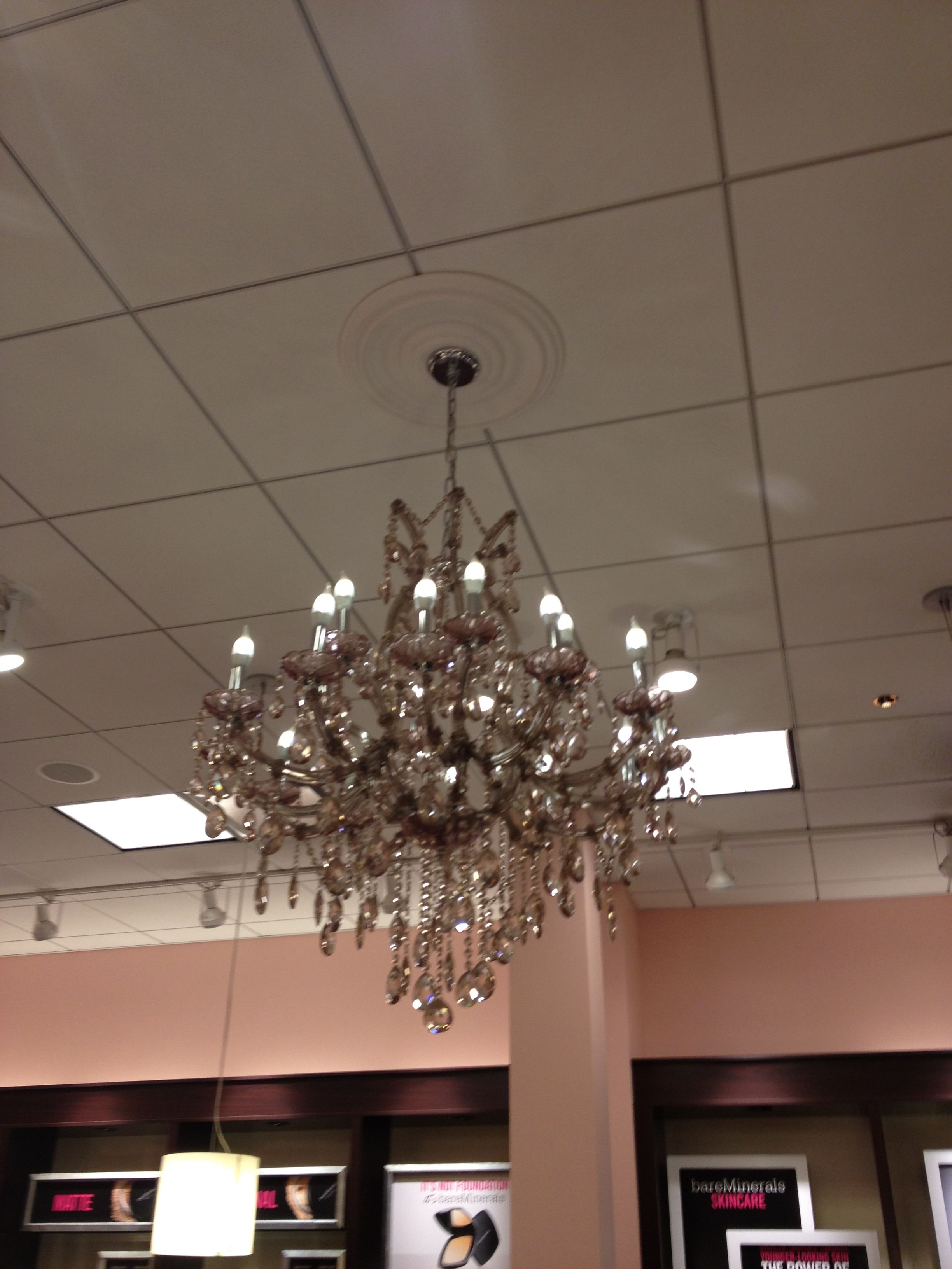 This chandelier is tinges with mauve rather than straight-on clear and is at least glass rather than the plastic I've seen too often lately. Found in the Bare Essentials Store as part of their fixtures.