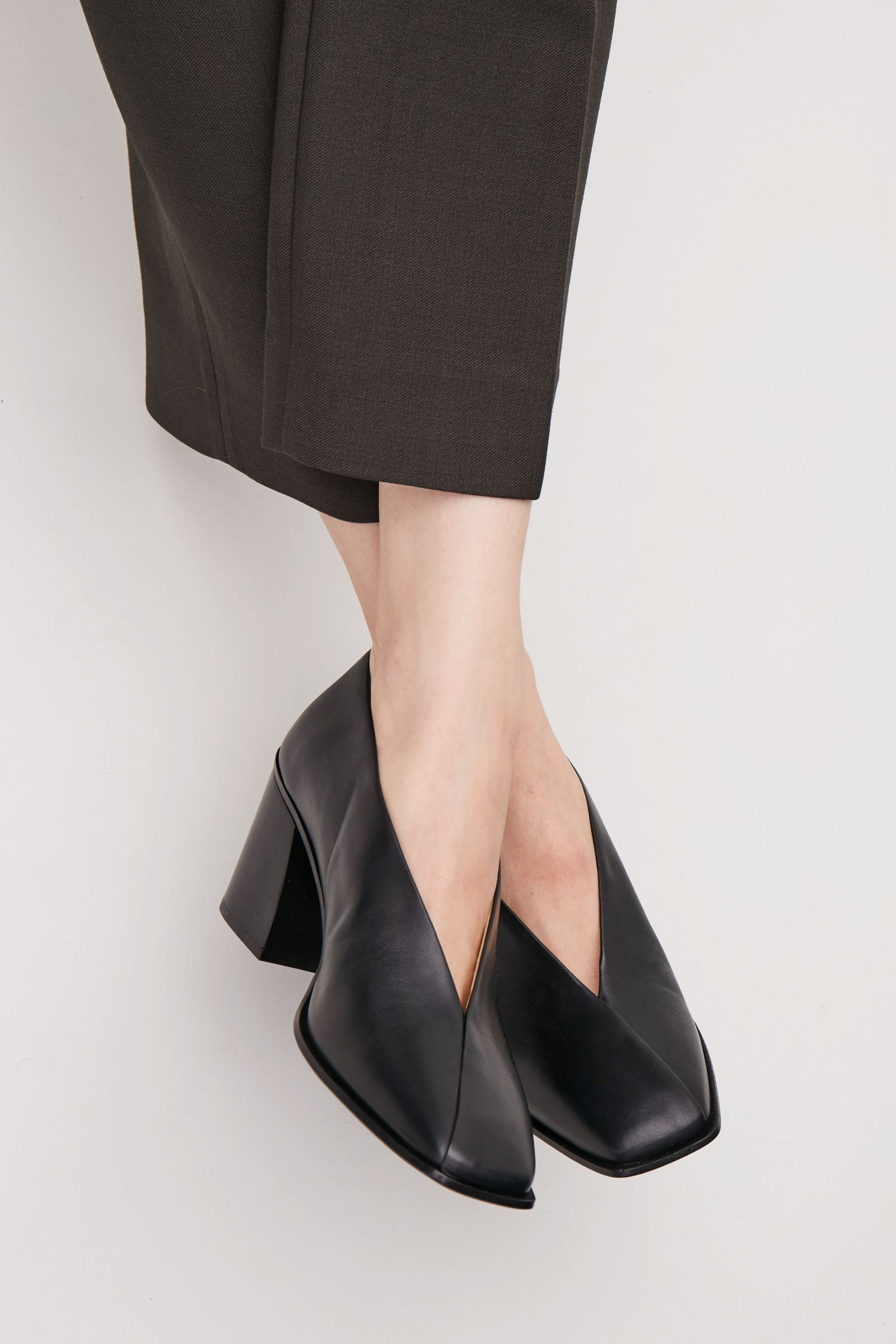 1918d39527e  190 COS image 5 of Square-toe pumps with fold detail in Black ...