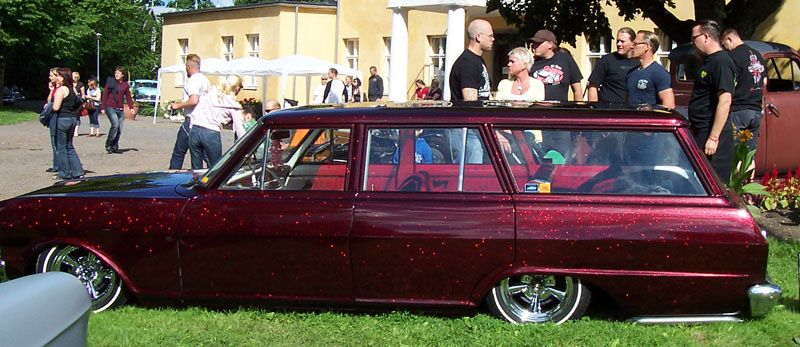 A Car Painted With Our Red Flakes At A Rockabilly Car Show In