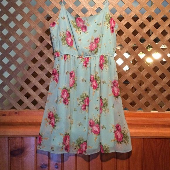 Dress Light blue and floral designed dress, worn only once! Great condition! NEED TO CLEAR MY CLOSET! Charlotte Russe to sell Charlotte Russe Dresses