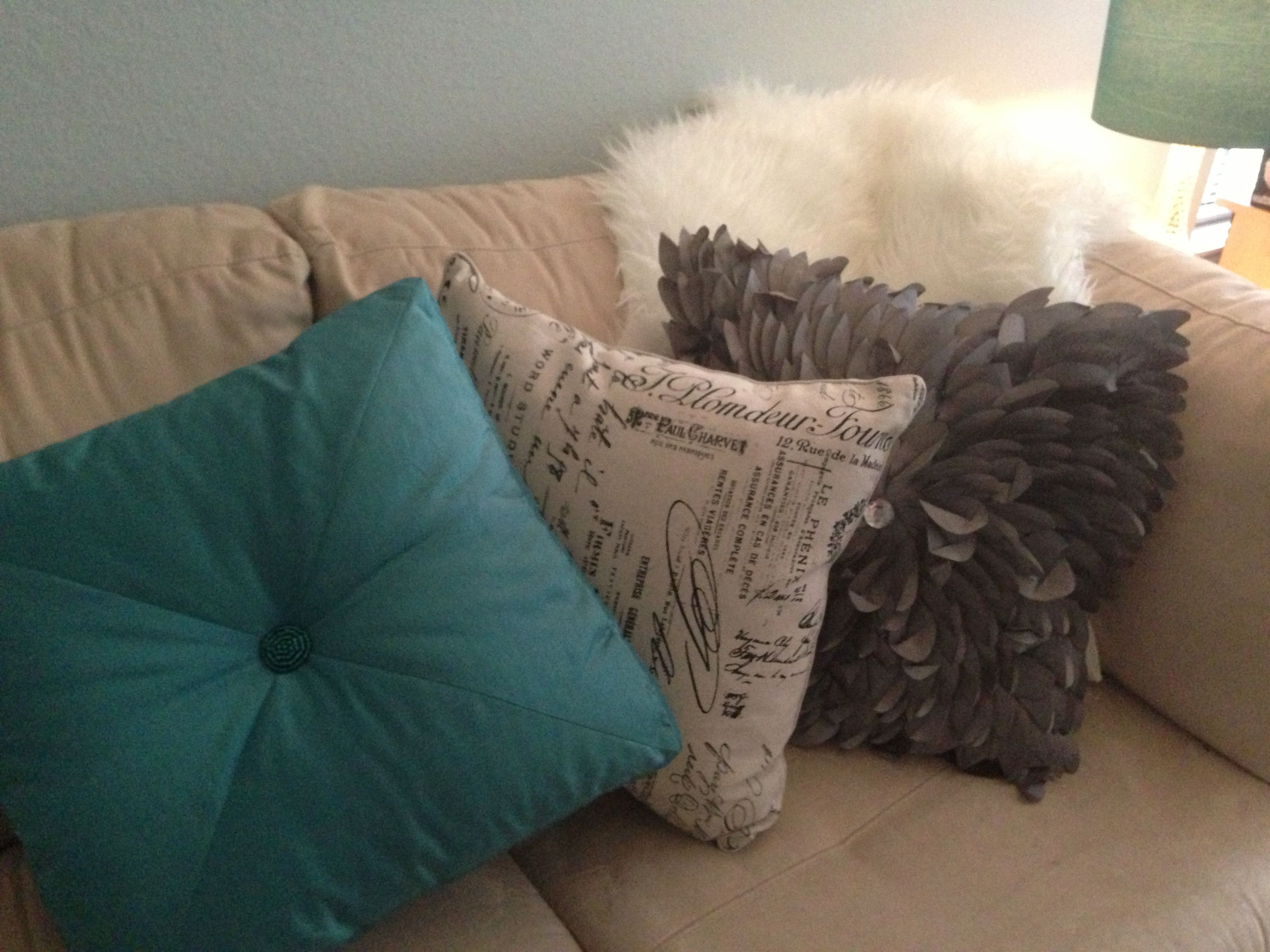 Teal And Cream Decorative Pillows : Throw pillows on cream couch - teal pillow, cream with writing, and shaggy grey pillow with ...