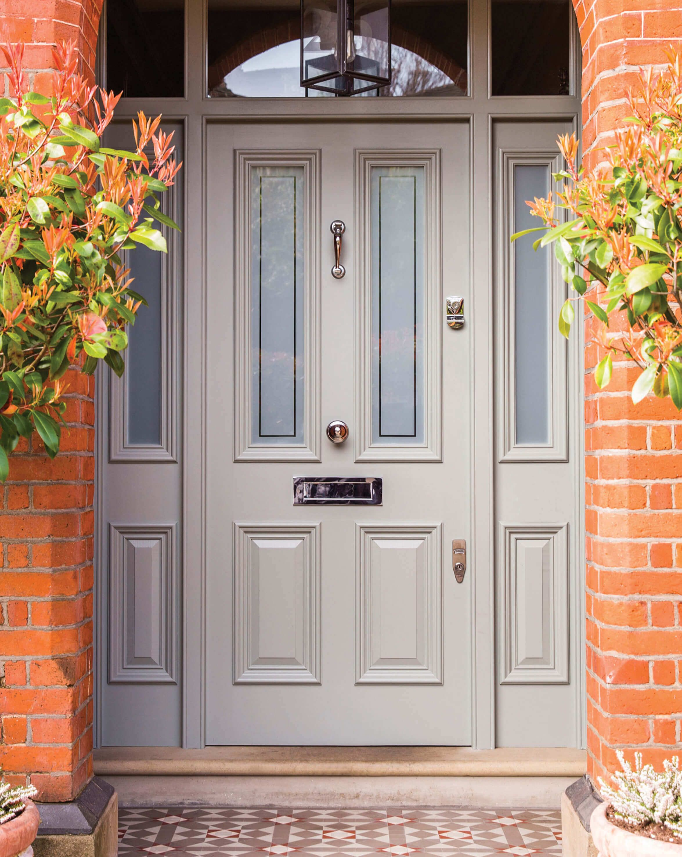 Heritage grey Victorian front door and solid door frame with side lights. Opaque etched glazing and polished chrome door furniture complete the look. #victorianfrontdoors