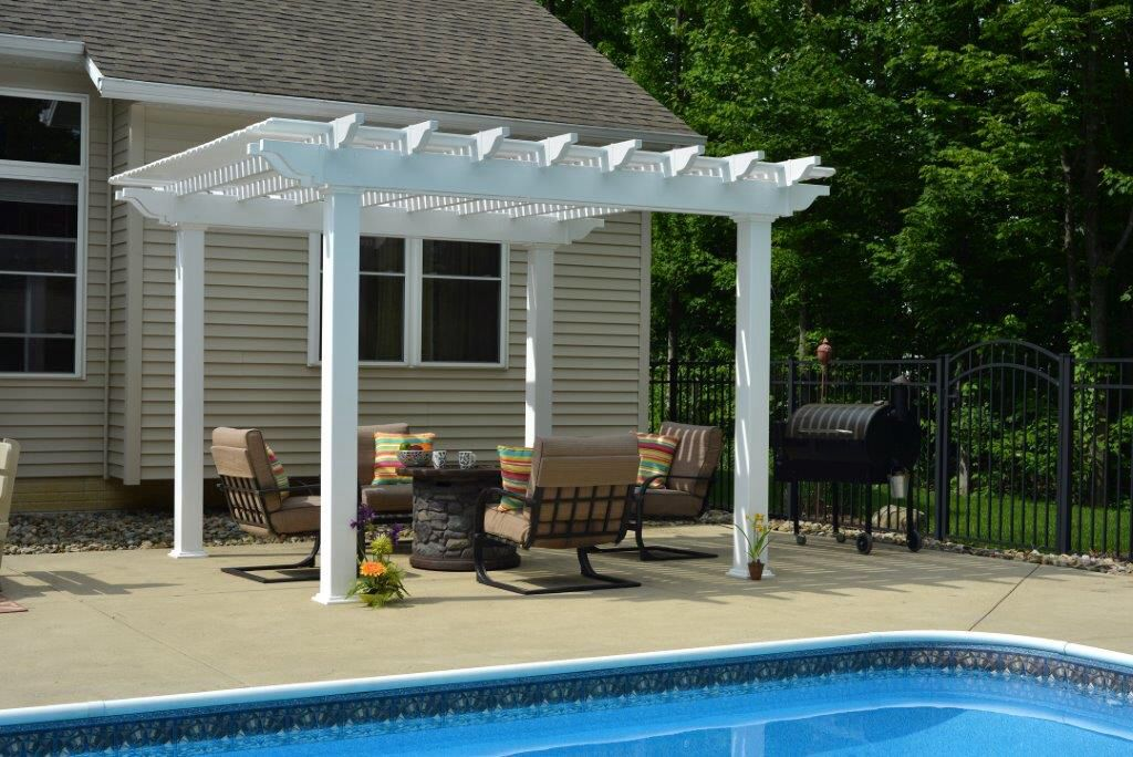 A Berlin Gardens Pergola In White Vinyl Adds Beauty To A Poolside And  Creates A Shaded