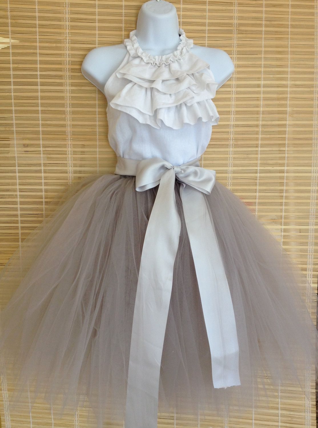 Tulle and ribbon and a simple halter ruffle top. Think I will try this but dont know if I want it long to the floor or right below the knee!!! Decisions!!!!