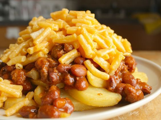 Chili-Mac and Cheese Fries : It's time to start a campaign for french fries topped with chili and macaroni and cheese to be sold in sports stadiums across the country. But until that happens, you can re-create this soon-to-be-classic at home with just three items from the grocery store: frozen fries, canned chili, and boxed mac and cheese (of course).