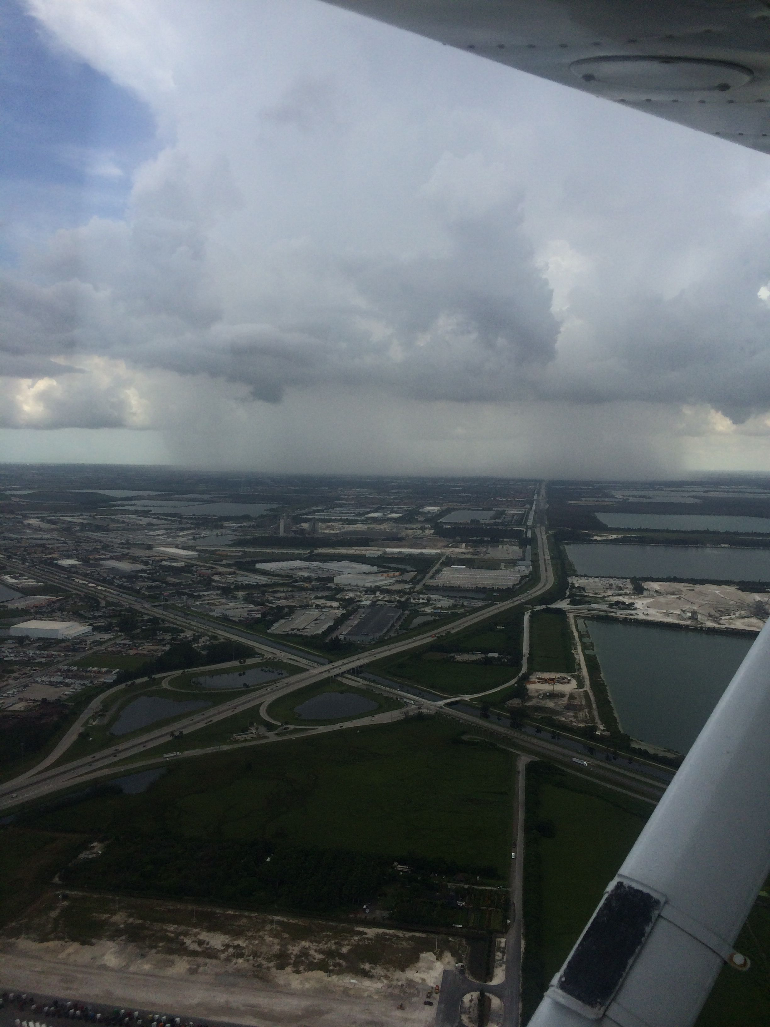 I took this photo a few days ago, that big shadow cloud exactly above Miami International Airport  (KMIA). Fortunately we landed at Opa-Locka (KOPF) beside KMIA. Abd I hope weather condition for this month is better than before