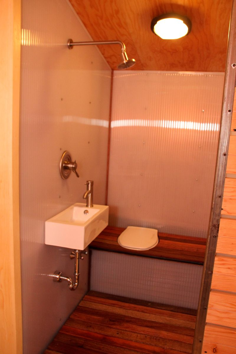idea for a wet bathroom in tiny house could do a fold down bench cover