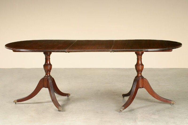 An Elegant Georgian Style Mahogany Double Pedestal Dining Table