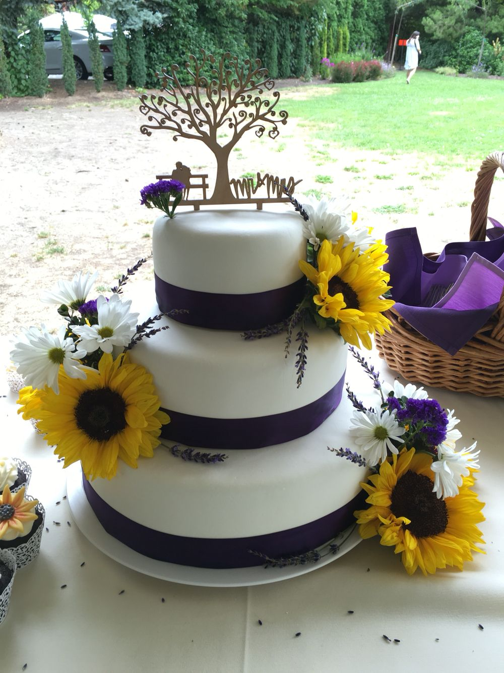 Sunflower wedding cake, lavender and honey middle tier