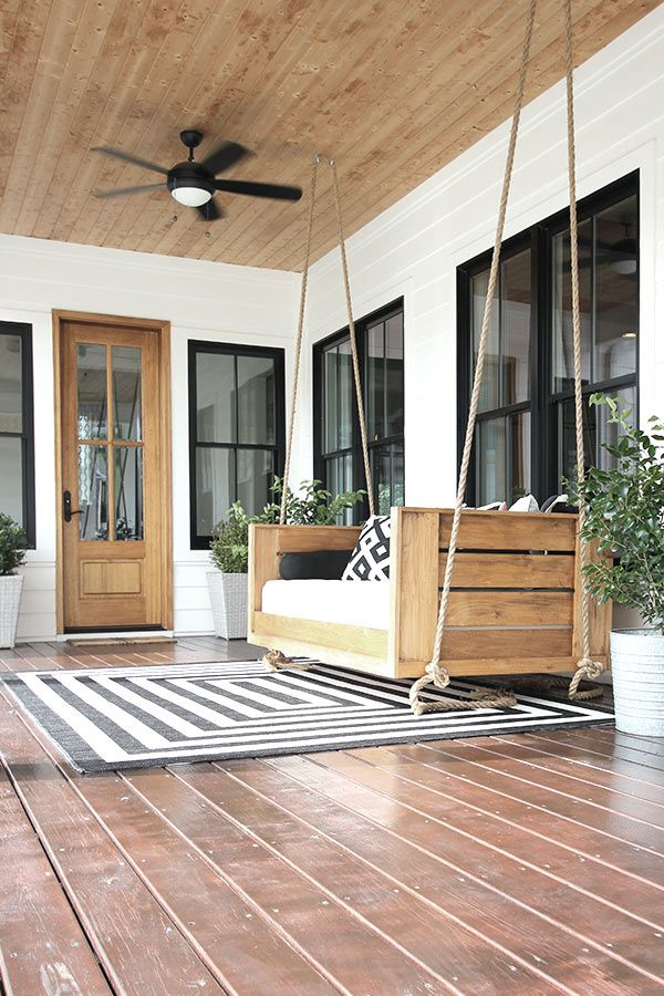 Our modern farmhouse back porch with swing bed. #modernfarmhouse #farmhouse #whitehouse #backporch #porch #porchswing