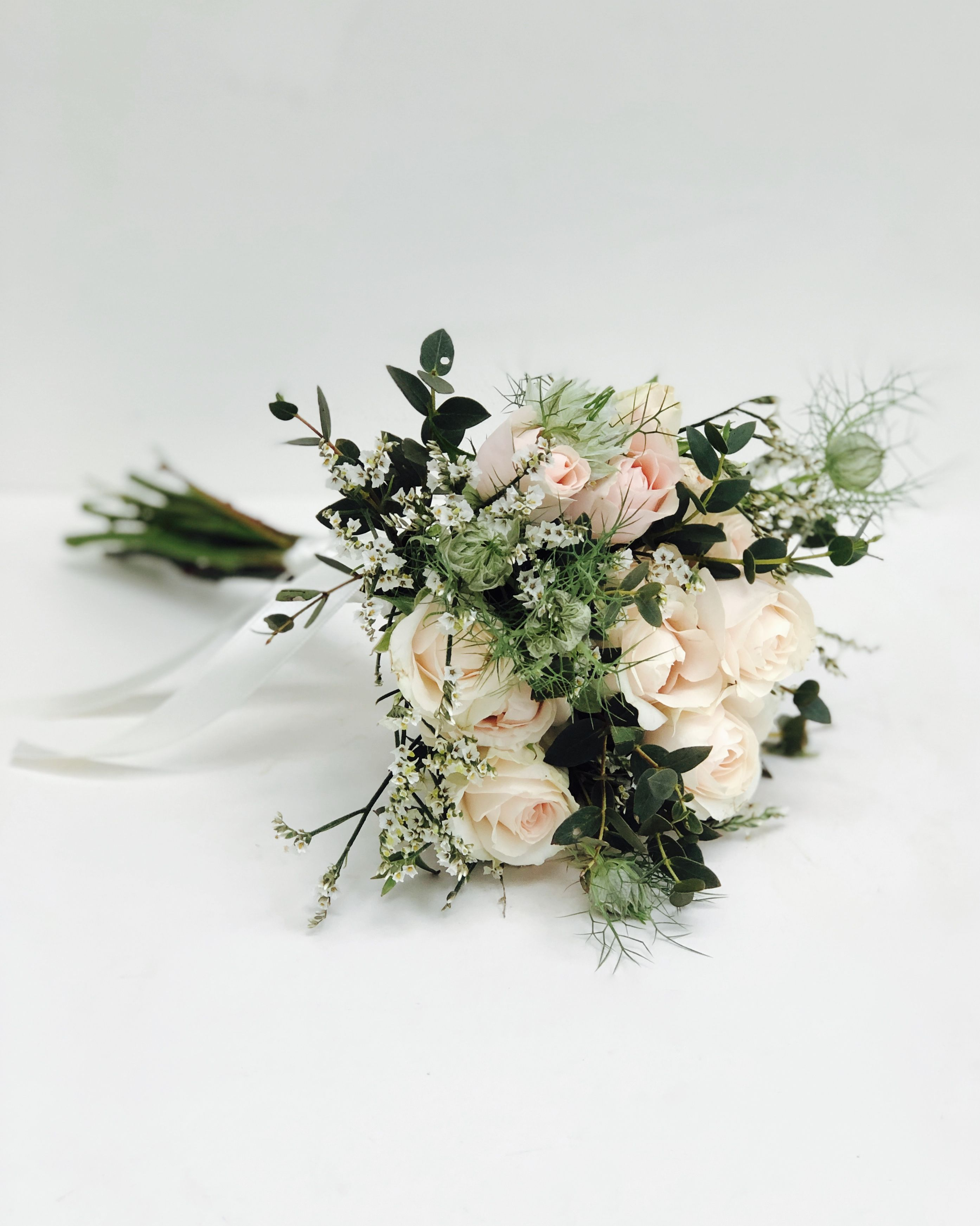 A small and simple bridesmaids bouquet with lovely spray roses, and some feathery nigella to add ...
