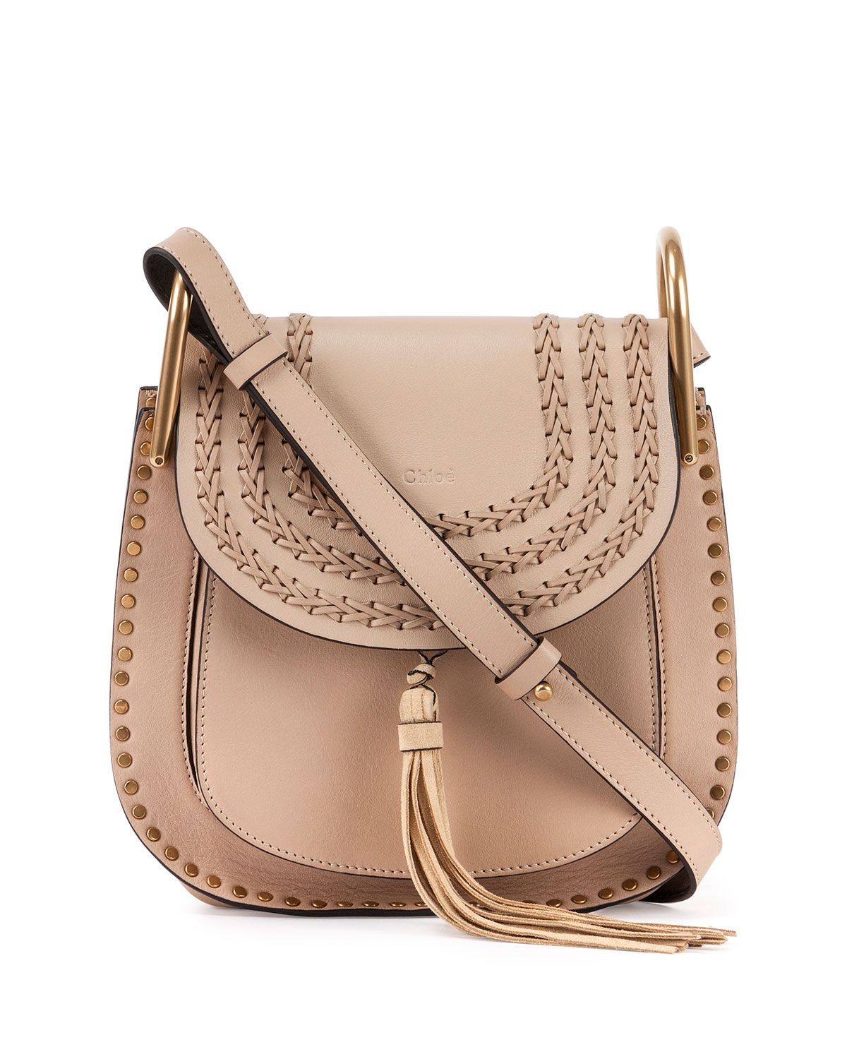 9e0d37d13d46 Chloe calfskin shoulder bag with woven and stud trim. Studs frame exterior  of horseshoe-shaped body. Adjustable shoulder strap with large U-shaped  rings  ...