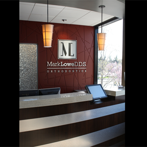 Logo Wall And Reception Desk Green Curve Orthodontic Office Design