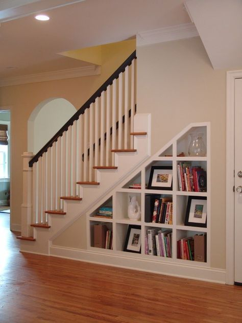 Book shelves under stairs