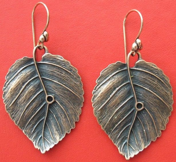 Copper leaf shaped drop earrings http://www.greykajewellery.com/shop/earrings/copper-leaf-shaped-drop-earrings/