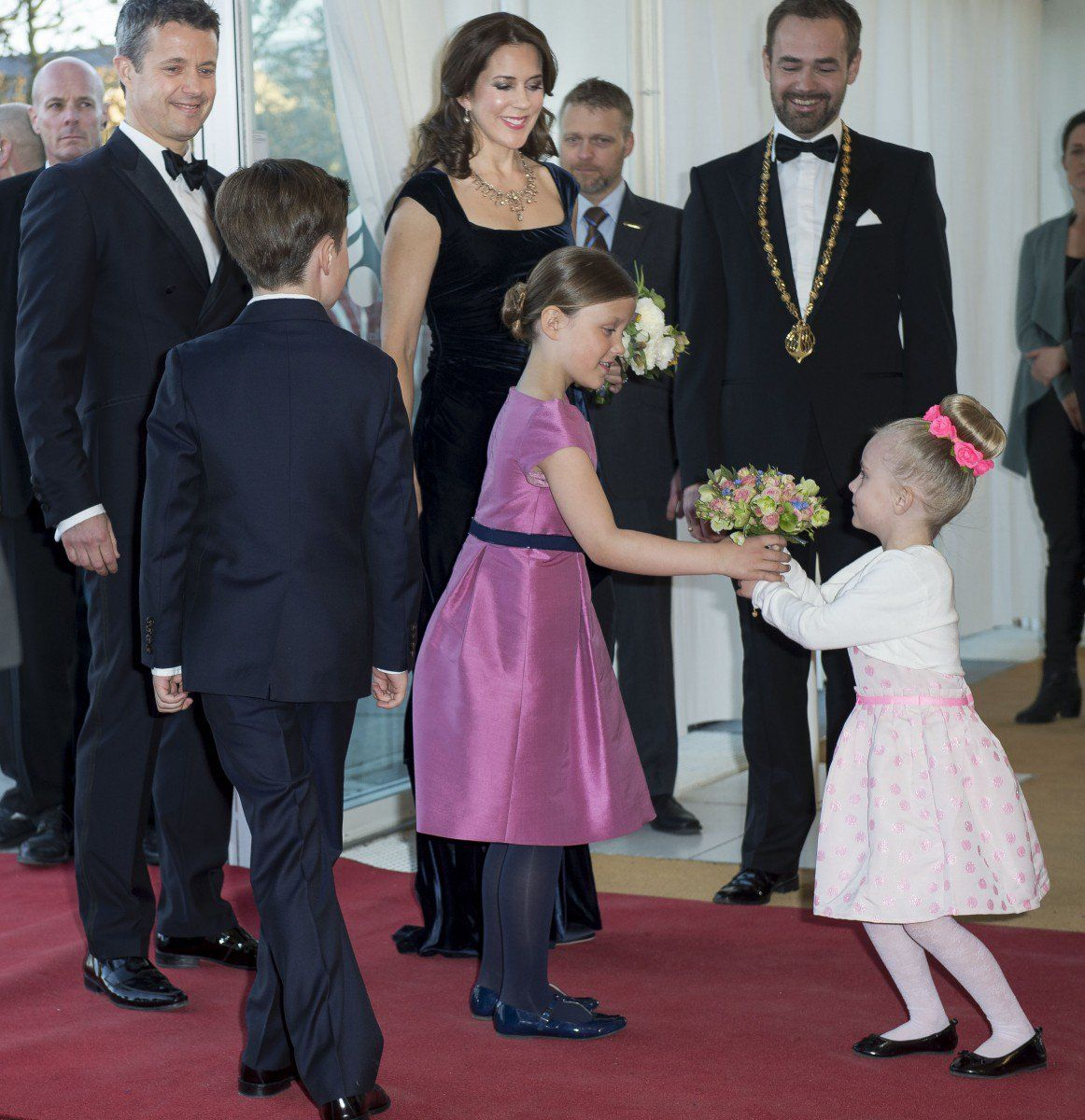 Princess Isabella arrived with her mum, dad and older brother and was given a bouquet of flowers by a girl who looked to be just a little younger than the Princess herself.