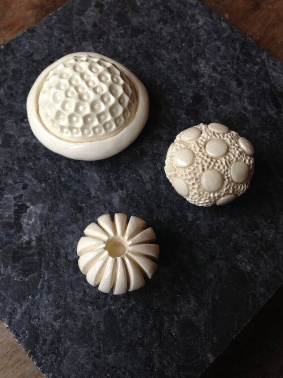Love these textured magnets! Hey, I found this really awesome Etsy listing at https://www.etsy.com/listing/184501840/set-of-3-handmade-white-ceramic-magnets