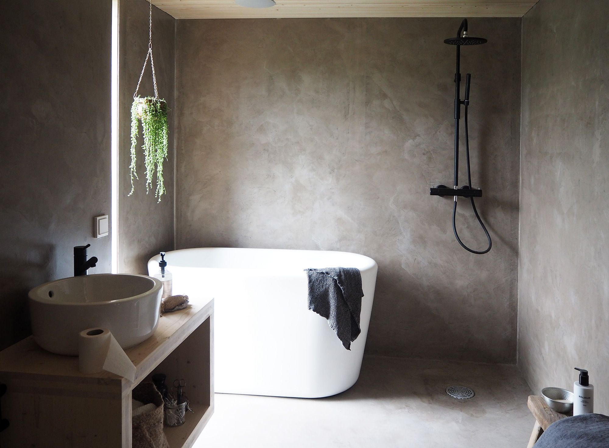 Modern minimalist bathroom with a slightly industrial feel.
